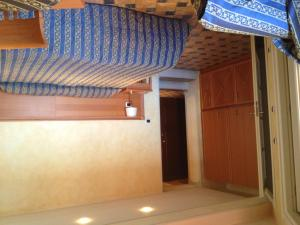 A bed or beds in a room at Residence Corte della Vittoria