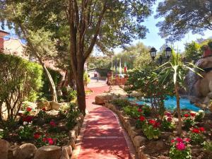 A garden outside Hotel Colonna San Marco