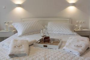 A bed or beds in a room at Agapi Suites