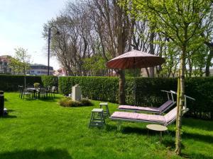 Jardin de l'établissement Hotel Apostrophe - De Haan