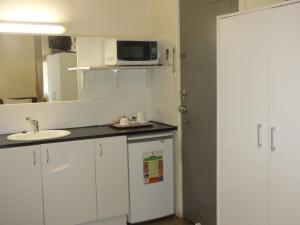 A kitchen or kitchenette at Calder Family Motel