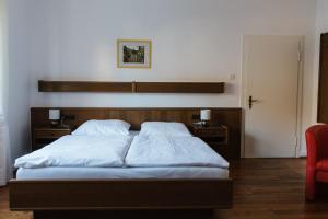 Een bed of bedden in een kamer bij Galerie Riesling