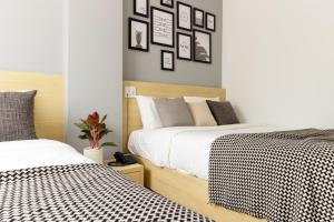 A bed or beds in a room at The Pergola Design Hotel