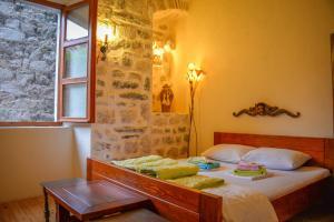Ein Bett oder Betten in einem Zimmer der Unterkunft Old Town Youth Hostel