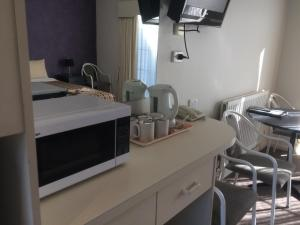 A kitchen or kitchenette at Ambassador Motor Inn