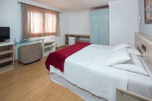 Cama ou camas em um quarto em Hotel Torre Sol