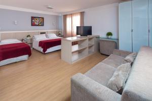 Uma área de estar em Hotel Torre Sol