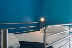 A bunk bed or bunk beds in a room at Casa das Conchas
