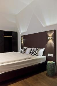 A bed or beds in a room at Arthotel Ana Symphonie
