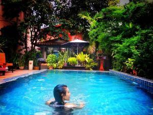 The swimming pool at or near Mandala House, Chiang Mai