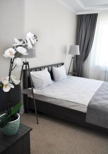 Кровать или кровати в номере Отель Прага