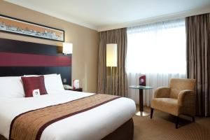 A bed or beds in a room at Crowne Plaza Manchester Airport, an IHG Hotel