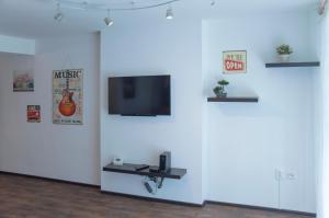 TV o dispositivi per l'intrattenimento presso Modern Apartment Dlouhá
