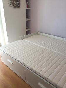A bed or beds in a room at T2 com vista mar