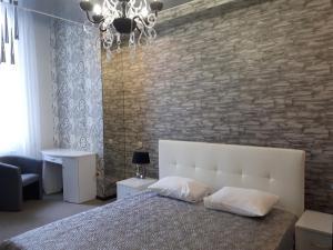 Кровать или кровати в номере Revizor