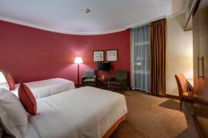 A bed or beds in a room at J5 RIMAL Hotel Apartments