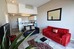 A seating area at Harbour Bridge Luxury Apartments
