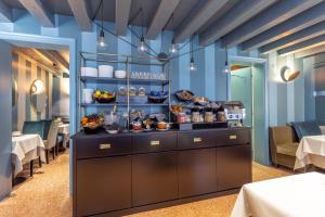 Restaurant ou autre lieu de restauration dans l'établissement Hotel Tiziano
