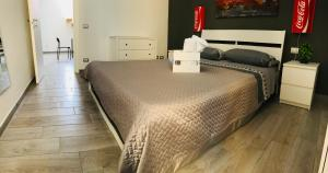 A bed or beds in a room at MariaFrancesca's House