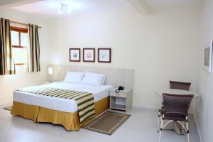 Кровать или кровати в номере Hotel Refúgio Vista Serrana