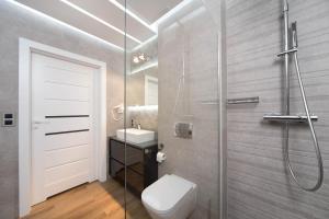Salle de bains dans l'établissement Exclusive Apartments Kraków Kazimierz