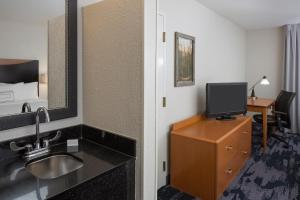 A television and/or entertainment center at Fairfield Inn & Suites by Marriott Orlando Lake Buena Vista
