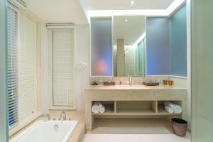 A bathroom at Rest Detail Hotel Hua Hin