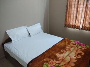 A bed or beds in a room at Spring Gardens homestay