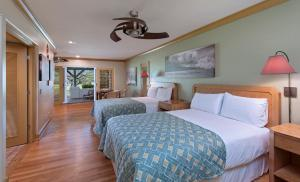 A bed or beds in a room at Hana-Maui Resort, a Destination by Hyatt Residence