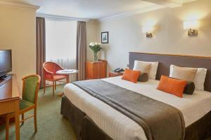 A bed or beds in a room at Lancaster Gate Hotel