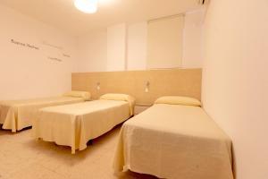 Cama o camas de una habitación en Hostal La Pilarica