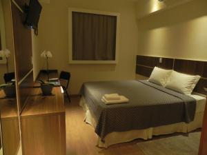 Cama ou camas em um quarto em Druds Hotel Hortolândia