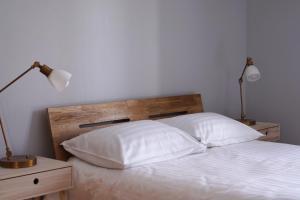 Gulta vai gultas numurā naktsmītnē Guest House Villa Dole
