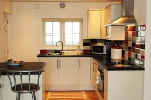 A kitchen or kitchenette at Two Moors Retreat