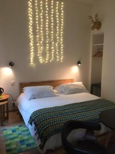A bed or beds in a room at B11hotel