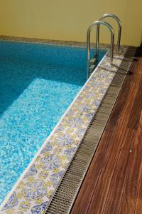 The swimming pool at or near Infante Sagres – Luxury Historic Hotel
