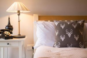 A bed or beds in a room at The Seagrave Arms