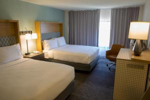 A bed or beds in a room at Holiday Inn Orlando International Airport, an IHG Hotel