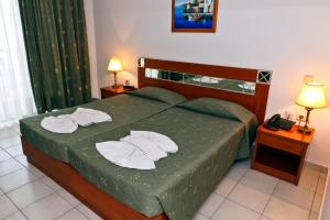 A bed or beds in a room at Gaia Village