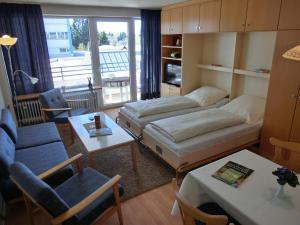 Ein Sitzbereich in der Unterkunft Haus Bergland