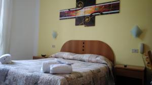 Letto o letti in una camera di Hotel Tirreno