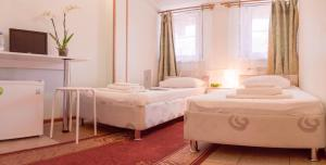 A bed or beds in a room at Andron Hotel on Ilyicha Square