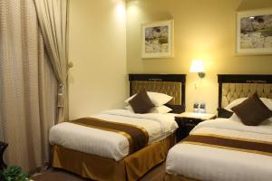 Cama ou camas em um quarto em Levant Hotel