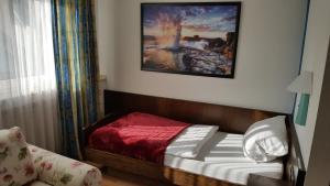Кровать или кровати в номере S&L Hotel Neuss