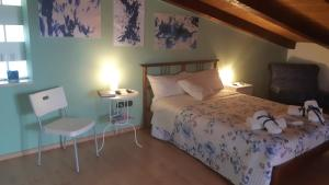 A bed or beds in a room at La Castellana