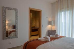 A bed or beds in a room at Marvellous Villa