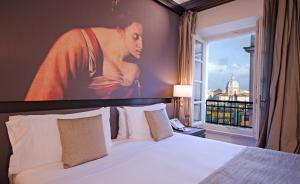 A bed or beds in a room at Villa Agrippina Gran Meliá – The Leading Hotels of the World