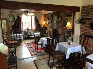 A restaurant or other place to eat at Englands Rose