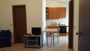 A kitchen or kitchenette at Apartment
