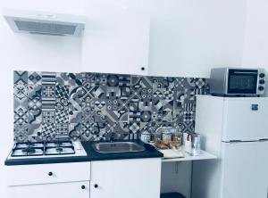 A kitchen or kitchenette at MariaFrancesca's House